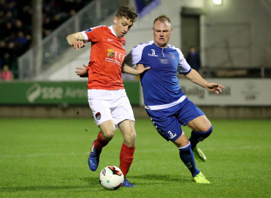 Connor Ellis under pressure from Robbie Williams while playing for Cork City against Limerick last March.