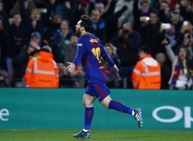 Messi wheels away in celebration.