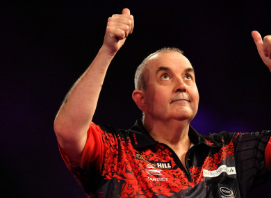 Phil Taylor celebrates reaching the World Darts Championship final.
