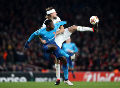 Ostersunds FK's Curtis Edwards and Arsenal's Danny Welbeck in action.