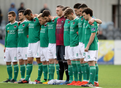 The Cork City players stand for a minute's silence in memory of Miller yesterday.