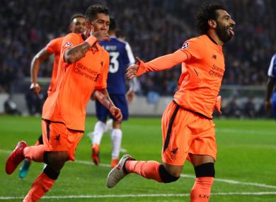 Liverpool stars Roberto Firmino and Mohamed Salah.