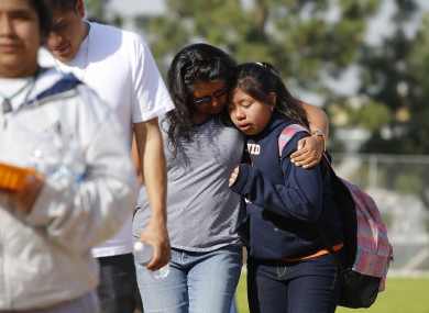 People pick up students after the shooting at the LA school