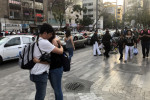 People gathering on a street after a tremor was felt in Mexico City