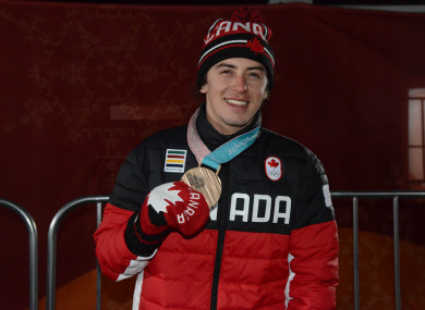Mark McMorris of Canada poses with his bronze medal from the Men's Slopestyle event.