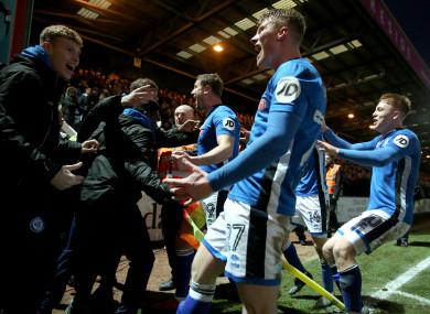 Goalscorer Steve Davies celebrates with team-mates and fans.
