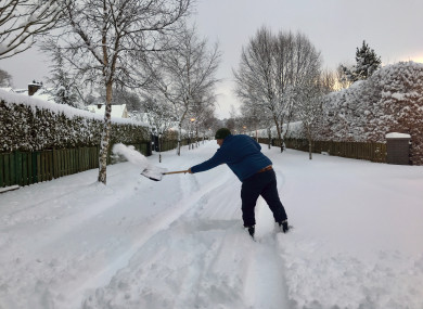 Anthony Ryan shovelling snow at the entrance to Millers Weir, Athgarvan, Co Kildare during the week