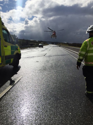 Gardaí at the scene of a collision on the M7 yesterday, where a person had to be airlifted to hospital as precaution