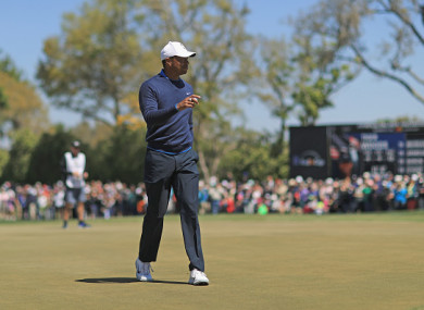 Woods reacts to a putt.
