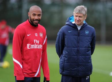 Henry pictured alongside Arsenal boss Arsene Wenger in 2011.