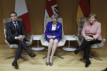 Britain's Prime Minister Theresa May, along with French President Emmanuel Macron and German Chancellor Angela Merkel
