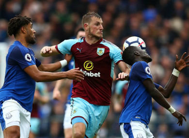 Burnley striker Chris Wood battles for the ball