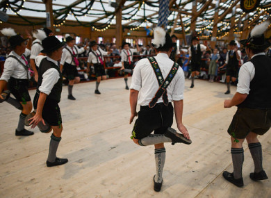 Boys in traditional bavarian Lederhosen perform a 'Schuhplattler' dance.