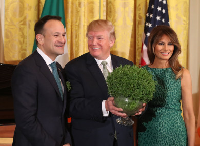 Taoiseach Leo Varadkar presents US President Donald Trump with a bowl of shamrock as Melania Trump looks on during the annual presentation ceremony at the White House.