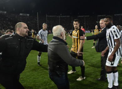 Paok president Ivan Savvidis takes to the pitch in Thessaloniki.