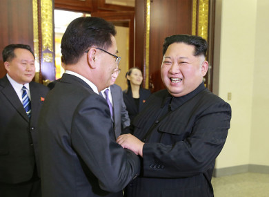 This picture - taken on 5 March 2018 and released from North Korea's official Korean Central News Agency (KCNA) on 6 March 2018 - shows North Korean leader Kim Jong-Un (right) shaking hands with South Korean chief delegator Chung Eui-yong