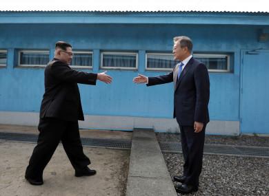 North Korean leader Kim Jong Un, left, prepares to shake hands with South Korean President Moon Jae-in at the border village of Panmunjom.