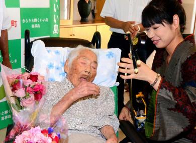 Nabi Tajima, 117, pictured during a celebration at a nursing home on 18 September 2017 in Kikai, Kagoshima, Japan