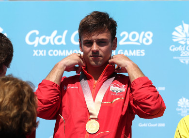 England's Tom Daley with his gold medal in the Men's Synchronised 10m Platform Final at the Optus Aquatic Centre during day nine of the 2018 Commonwealth Games