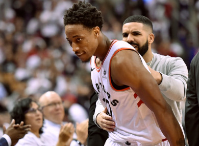 Drake gives DeMar DeRozan some tips from court side last night.
