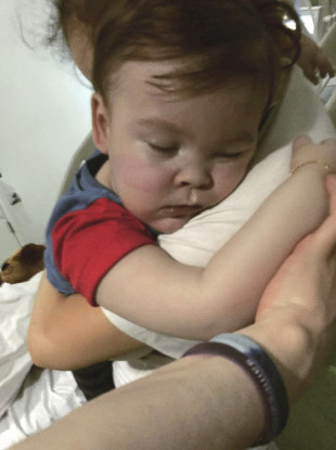 Alfie Evans with his mother Kate James at Alder Hey Hospital, Liverpool, England