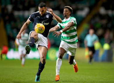Dundee defender Steven Caulker clears with Scott Sinclair close by.