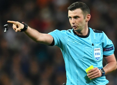 Referee Michael Oliver in action in the Champions League