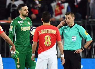 Monaco players Joao Moutinho and Danijel Subasic with referee Clement Turpin during yesterday's final.