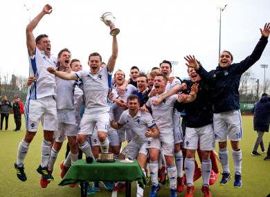 Three Rock Rovers captain Jody Hosking lifts the Irish Senior Cup.