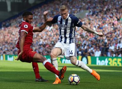 McClean up against Liverpool defender Joe Gomez in a recent Premier League game.