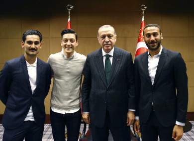 Turkey's President Recep Tayyip Erdogan, right, poses for a photo with Turkish Premier League soccer players Ilkay Gundogan, left, Mesut Ozil, second left, and Cenk Tosun in London.
