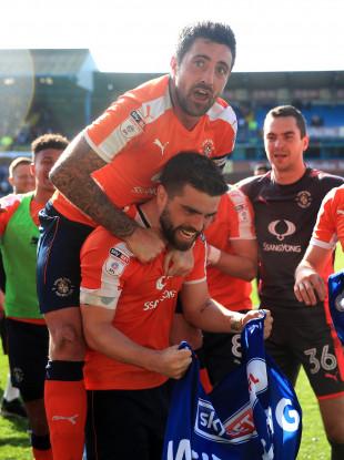 Alan Sheehan (top) celebrates Luton Town's league promotion.