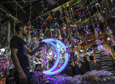 A Palestinian vendor sells Ramadan lanterns in his shop in a market on the first day of the holy month.