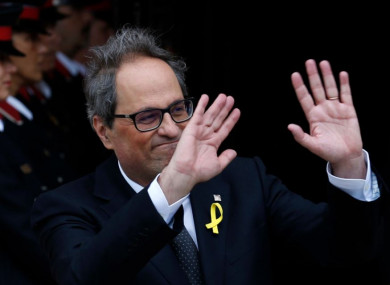 Newly appointed Catalan President Quim Torra leaves parliament today in Barcelona, Spain.