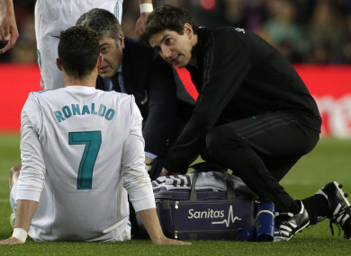 Real Madrid's Cristiano Ronaldo is treated for an injury after scoring his side's first goal against Barcelona at the weekend.