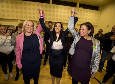 Sinn Fein Stormont leader Michelle O'Neill (left) and Sinn Fein President Mary Lou McDonald raise the arms of Orfhlaith Begley as the newly elected Sinn Fein MP for West Tyrone.
