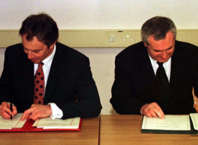 Former UK Prime Minister Tony Blair and former Taoiseach Bertie Ahern signing the Good Friday Agreement in 1998.