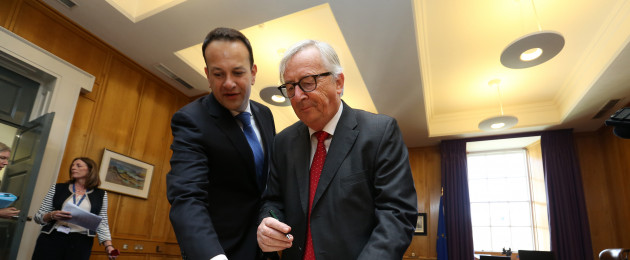 Taoiseach and Fine Gael leader Leo Varadkar (L) with President of the European Council, Jean-Claude Juncker as he signs the visitors book in Government Buildings