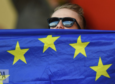 Young person shows support with European flag