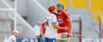 Waterford's Darragh Lyons and Cork's Robbie O'Flynn at the final whistle.