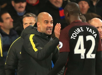 Manchester City manager Pep Guardiola (left) and Yaya Toure