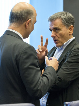 Greek finance minister Euclid Tsakalotos making a point to an EU colleague.