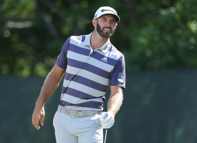 Dustin Johnson reacts to his tee shot on the second hole.
