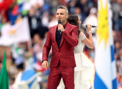 Robbie Williams and Aida Garifullina perform at the opening ceremony.