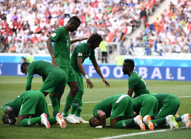 The Saudi players celebrate scoring.
