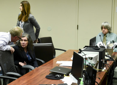 Louise Anna Turpin, second left, talks with an investigator as her husband David Allen Turpin, right, looks on during a court appearance in Riverside, California.