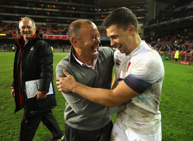 Jones celebrates yesterday's win over the Springboks with Ben Youngs.