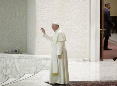 Pope Francis leaves after an audience with an association of people honored by the Italian Presidency at the Vatican.