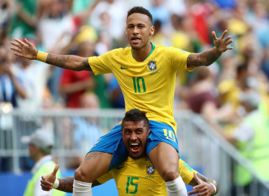 Brazil's Neymar (centre) celebrates scoring his side's first goal of the game.