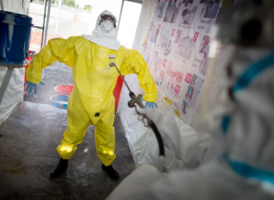 People in in protective suits prepare for a demonstration of their work at the SITTU (Severe Infections Temporary Treatment Unit) in Monrovia, Liberia in April 2015.